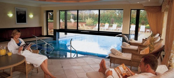 Relaxing in chairs next to indoor pool